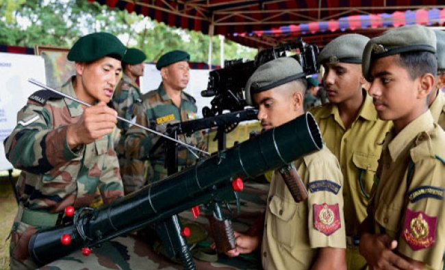 NCC cadets having a look of a rocket launcher during a \'Know Your Army Mela\' in Bengaluru...