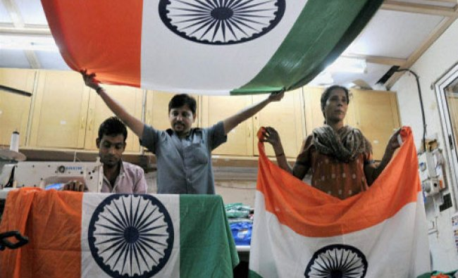Workers prepare Indian flags ahead of Indpendence Day celebertations at a shop in Mumbai...