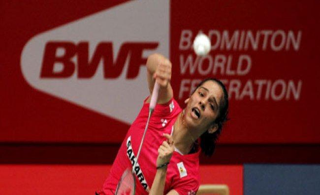 Saina Nehwal returns a shot from Japan\'s Sayaka Takahashi during their women\'s singles badminton...