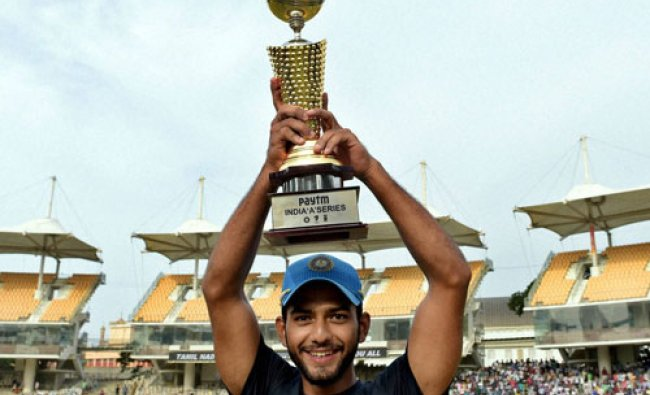 India \'A\' skipper Unmukt Chand holds the winning trophy after the final match of ...