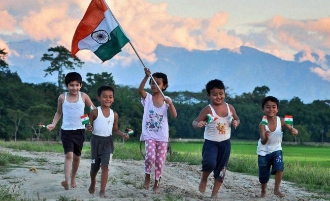 Children run with Tricolors on the eve of Independence Day...