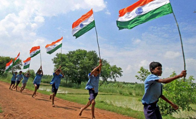 School children run with Tricolours in a village ahead of...