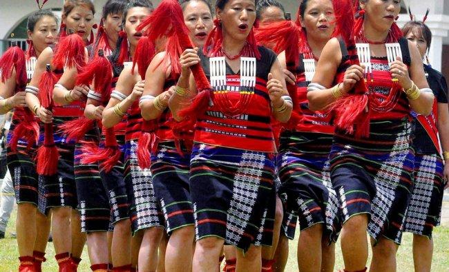 Naga tribal women perform during the celebration of 69th Naga Independence Day...