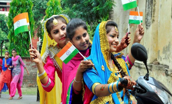 School girls leave after taking part in Independence Day...
