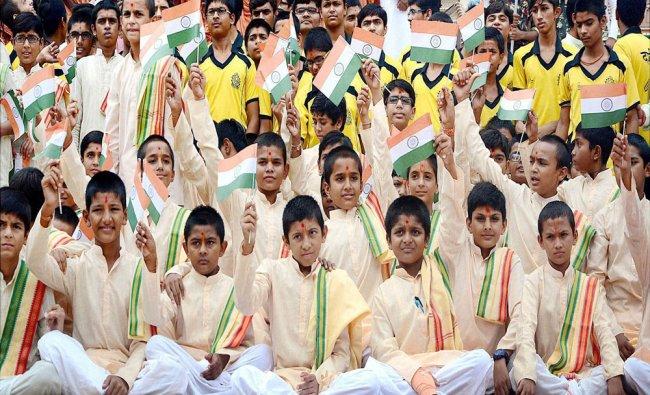 Students of Swaminarayan Gurukul holds tricolour to mark...