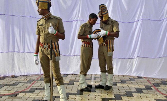 Indian policemen get ready before the start of India\'s Independence Day celebrations in Kochi...