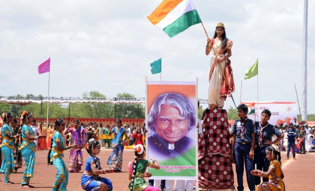 School children performed the dance as part of the 69th Independence Day Celebration...