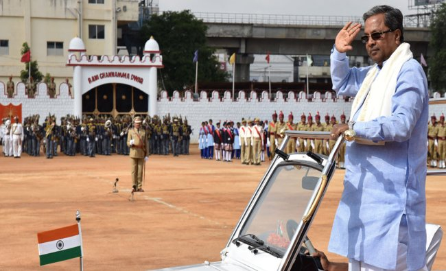 Siddramaiah inspecting the parade after hoisting the National Flag on the 69th Independence day...