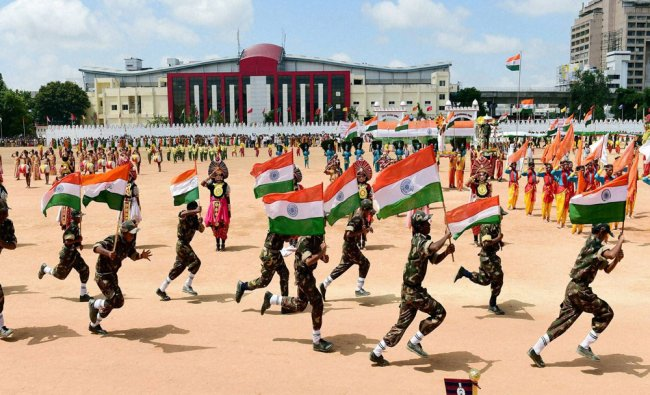 School children run with Tricolours during the 69th Independence day celebrations...