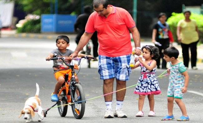 People along with their children enjoying their freedom during \'no vehicle day\' at Cubbon Park...