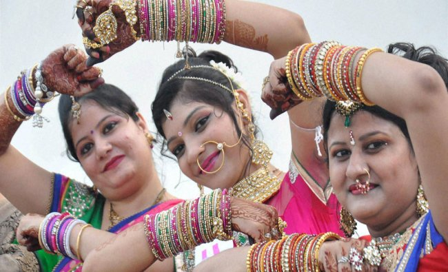 Women pose at a programme organised on the ocassion of Teej festival in Moradabad...