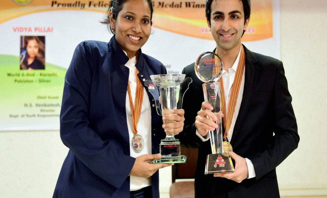 Cueists Pankaj Advani and Vidhya Pillai pose during a felicitation event organised by...