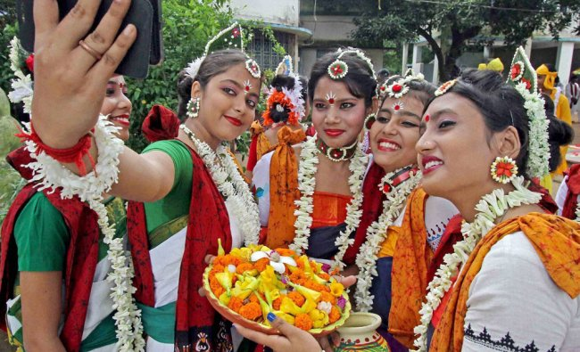Students of a school take a selfie during Brikhoropan (plantation of trees) programme...