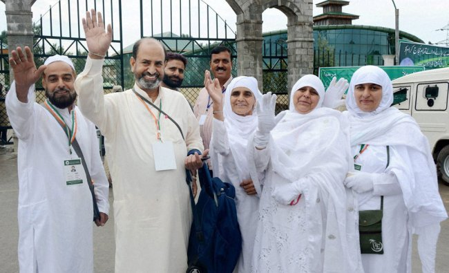 Pilgrims wave at their relatives as they leave for holy city of Mecca for Haj pilgrimage...