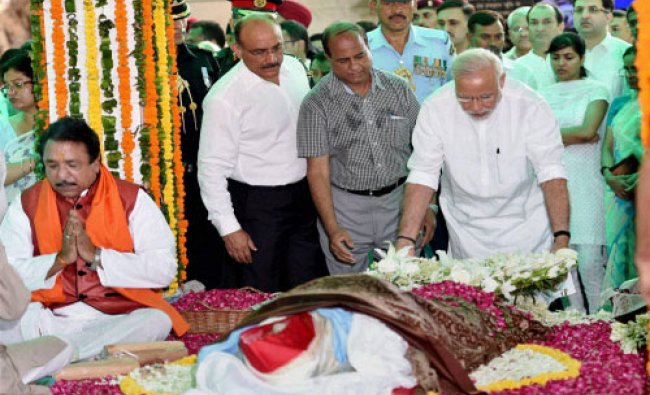 Prime Minister Narendra Modi paying his last respects to First Lady Suvra Mukherjee during her...