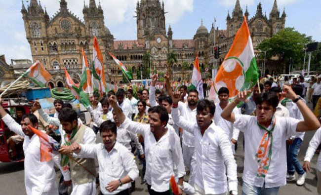 Youth Congress workers shout slogans during a protest rally against Maharashtra government...