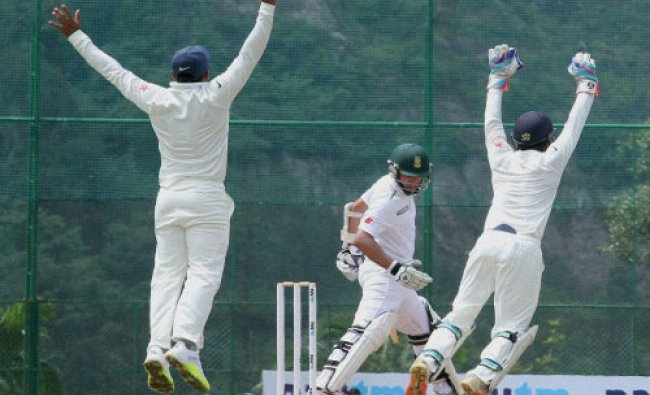 India-A team players appeal against South Africa-A team player Dane Piedt during the test cricket...