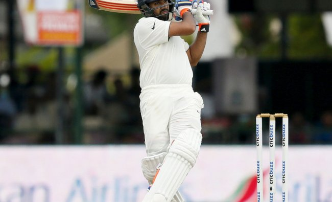 India\'s Rohit Sharma watches his shot during the first day of their second test cricket match...