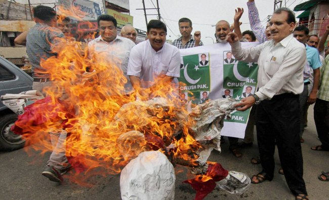 Activists of Jammu West Assembly Movement burn effigies during a protest against Pakistan...