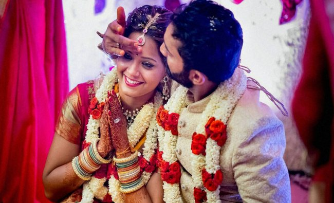Cricketer Dinesh Karthik and ace squash player Deepika Pallikal during their wedding ceremony...