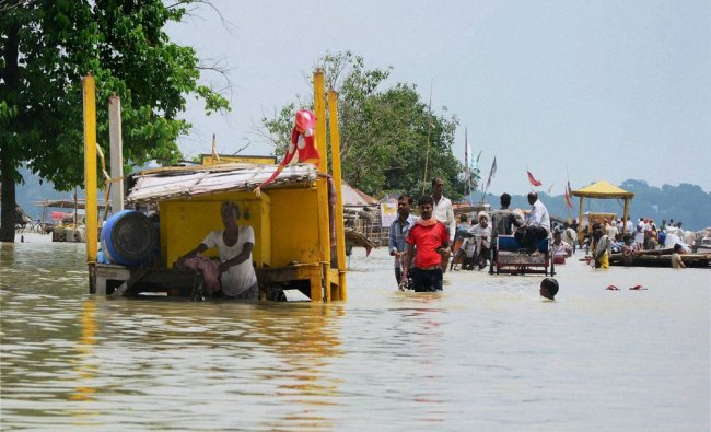 People shift with their belongings to safer places from the submerged areas...