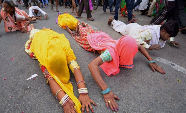 Devotees take part in religious Diggi Pad Yatra in Jaipur on Friday for darshan...