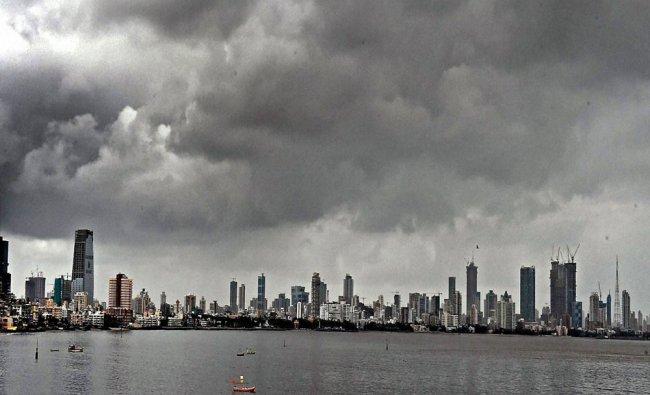 Dark clouds over the Mumbai skyline on...