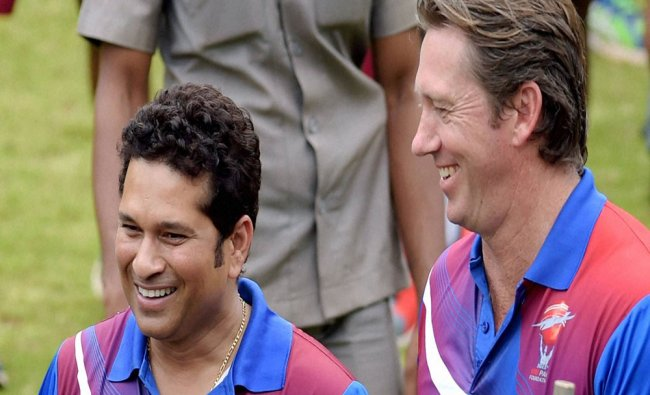 Cricket legends Sachin Tendulkar and Glenn McGrath interacting with young cricketers...