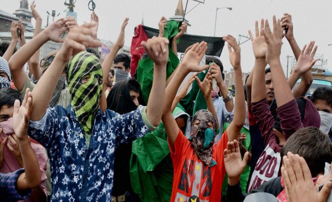 Protesters shout slogans during a protest against the house arrest of Hurriyat Chairman...