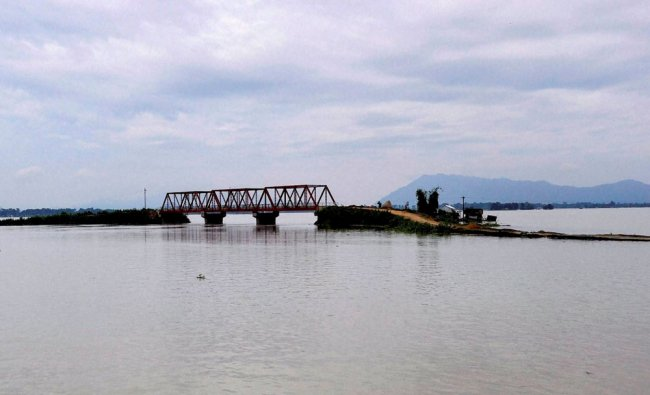 A link road is submerged in flood water at Pokaria village in Morigaon district of Assam...