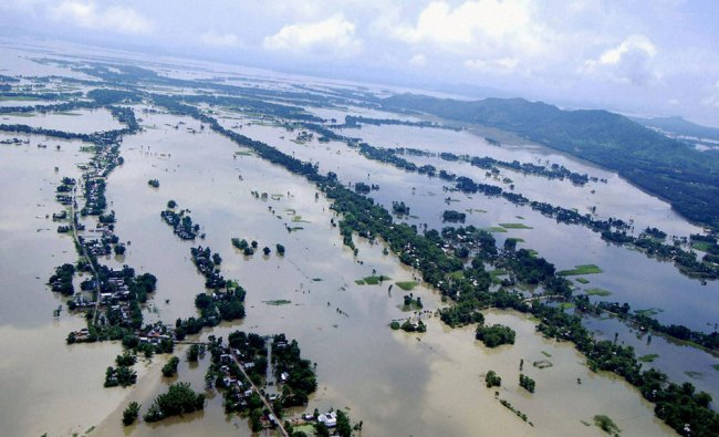 An aerial view of the flood affected districts of Lower Assam on Sunday....