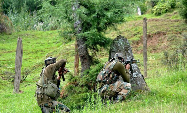 Army Personnel prepare to take on hiding militants during an encounter at Khumhair forests...