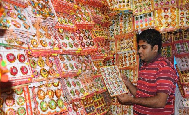 A shop man showing Rakhi for the coming Raksha Banahan festival...