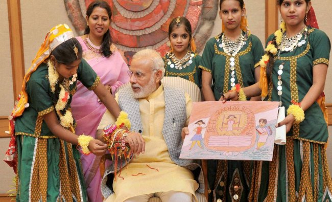 Women and Children from various segments of society tying Rakhi to Prime Minister...