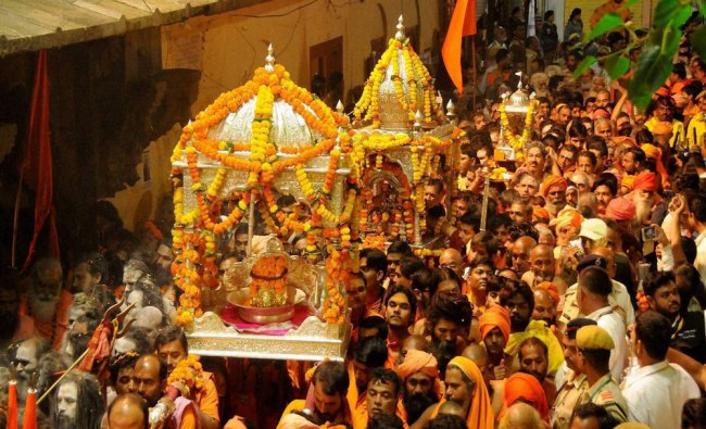 Mahants and sadhus from various Akharas arrive for the first Royal Bath of the Kumbh Mela...