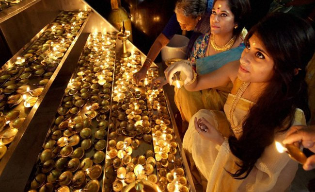 Malayali women light lamps at Lord Ayyappa Temple on the occasion of Onam festival...