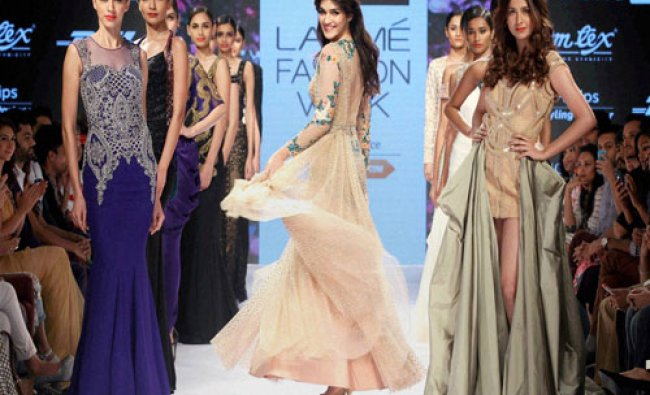 Bollywood actor Kriti Sanon walks the ramp displaying an outfit by designer...