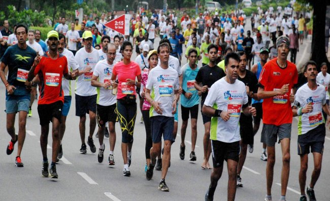Participants run during the Hyderabad Marathon 2015 which witnessed a massive turnout...