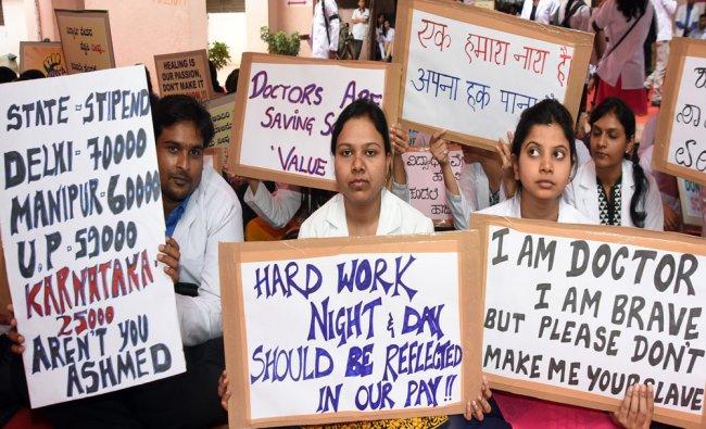A large number of Karnataka Association of Resident Doctors (KARD) members staged protest ...