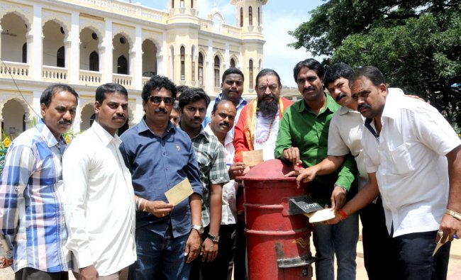 Members of Yuva Bharath organisation launch a postcard campaign demanding conduct of Dasara in a ...