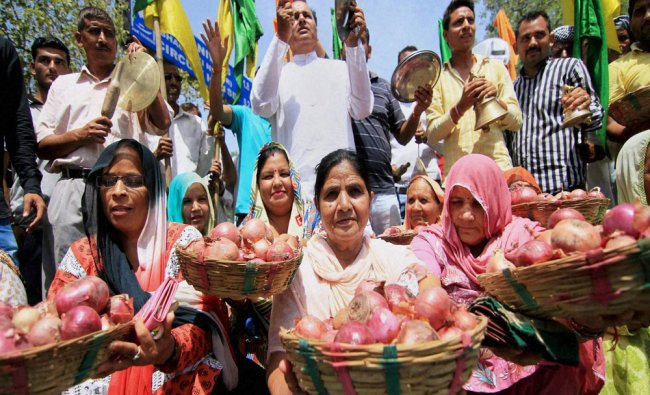 Local members of Shiv Sena and Dogra Front carrying onions to mark protest against price hike of ...