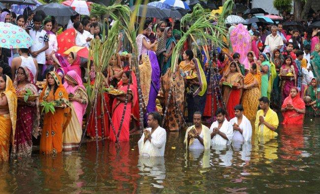 Devotees offer prayers at Sankey lake during Chhath Puja in Bengaluru...