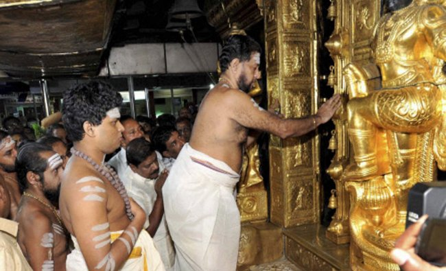 SE Sankaran Namboothiri opens sanctum santorum on the beginning of 41-days Mandala Pooja...