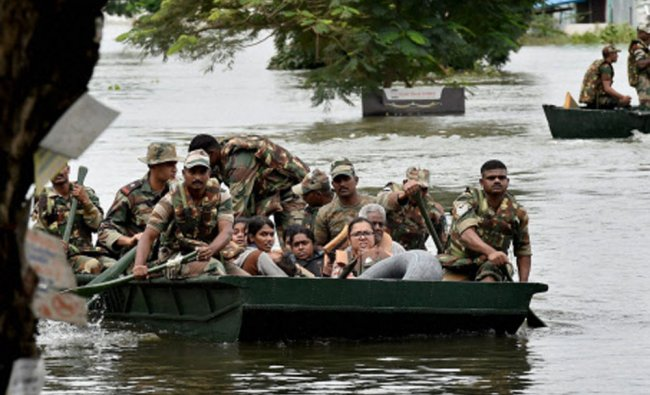 Army personnel rescuing people during their flood relief operations in rain-hit areas of Chennai...
