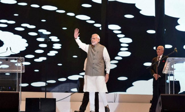 Prime Minister Narendra Modi waves to the people from Indian community during an event in...