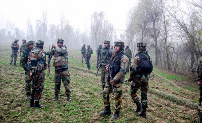 Army soldiers near the site of a gun-battle with militants in Silgam area of district...