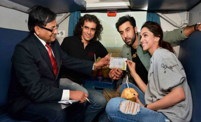 Director Imtiaza Ali along with actors Ranbir Kapoor and Deepika Padukone traveling by a train...