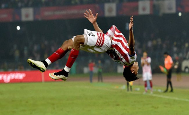 Atletico de Kolkata midfielder Sameehg Doutie jubilate after scoring goal against FC Goa during...