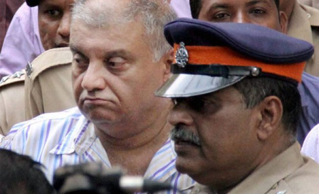Peter Mukerjea being produced at Esplanade court in Mumbai on Monday in connection with...