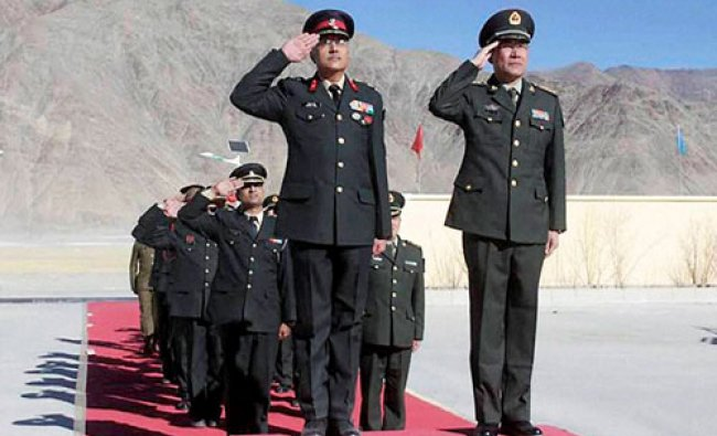 Indian Army and Chinese PLA officers during a ceremonial Border Personnel Meeting (BPM) on the...